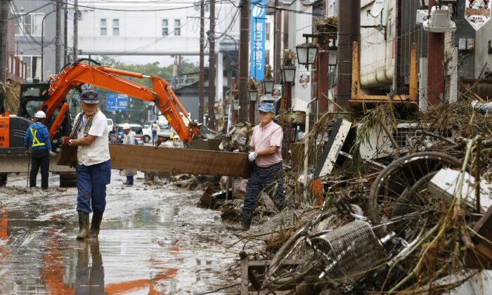 People work for recovery efforts as the city was affected by a heavy rain in Hitoyoshi, Kumamoto prefecture, southern Japan on July 9, 2020. (Kenzaburo Fukuhara/Kyodo News via AP)