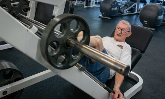 """Art Ballard does a leg press. """"At my age, the best thing you can do is find a routine."""" (Heidi de Marco, KHN)"""