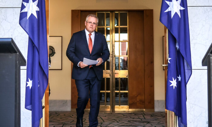 Australian Prime Minister Scott Morrison walks to a media conference at Parliament House in Canberra, Australia, on July 9, 2020. (David Gray/Getty Images)
