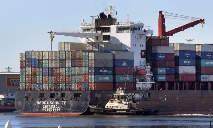 A container ship is pushed to its berth by a tug at the Port of Melbourne on June 6, 2018. (WILLIAM WEST/AFP via Getty Images)