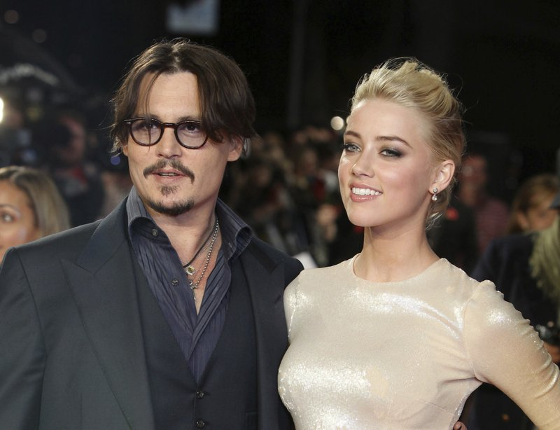 Actors Johnny Depp, left, and Amber Heard