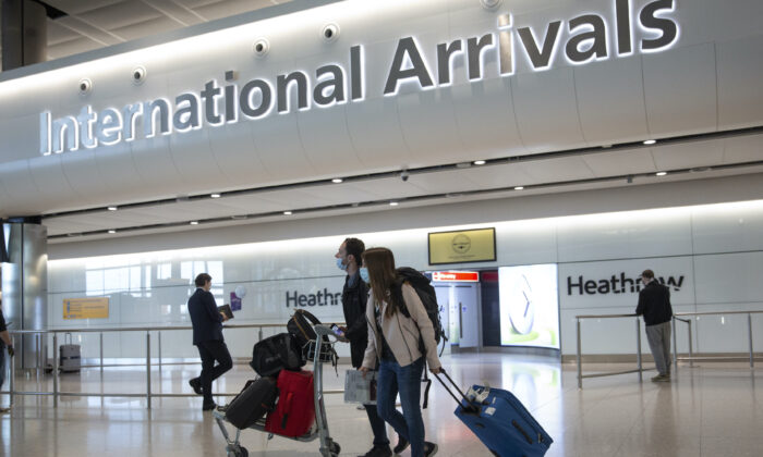 Passengers walk in London's Heathrow Airport, on July 8, 2020. (Matt Dunham/AP Photo)