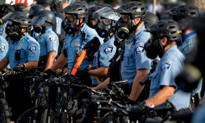 Police gather en masse as protests continue at the Minneapolis 3rd Police Precinct in Minneapolis on May 27, 2020. (Carlos Gonzalez/Star Tribune via AP)