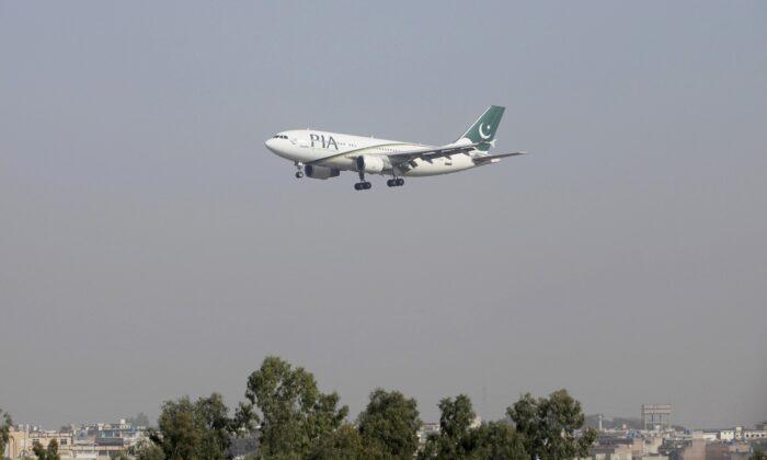 A Pakistan International Airlines (PIA) passenger plane arrives at the Benazir International airport in Islamabad, Pakistan, on Dec. 2, 2015. (Faisal Mahmood/File Photo/Reuters)