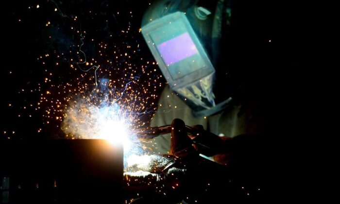A welder fabricates a steel structure at an iron works facility in Ottawa in a file photo. (The Canadian Press/Sean Kilpatrick)