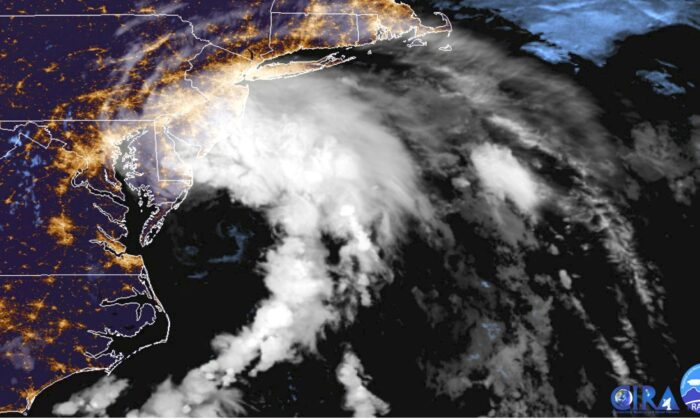 This GOES-16 satellite image taken at 9:30 UTC (5:30 a.m. EDT) on July 10, 2020 shows Tropical Storm Fay as it moves closer to land in the northeast of the United States. (NOAA via AP)