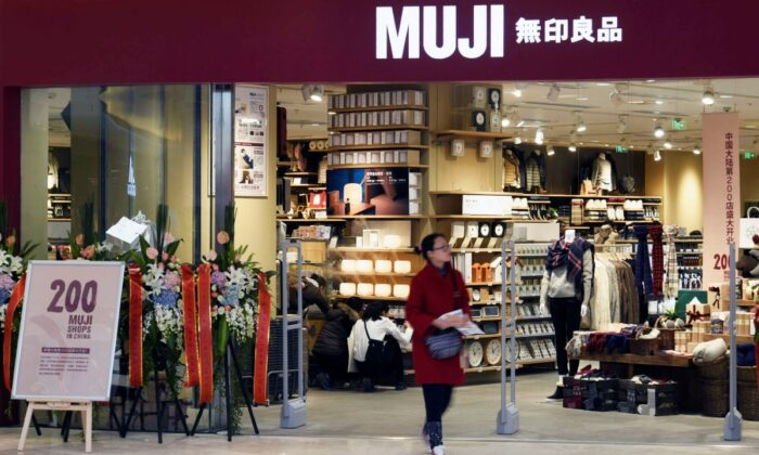 A woman walks outside a newly opened Muji store at a shopping mall in Hangzhou, Zhejiang province, China, December 12, 2016. (Stringer/Reuters)