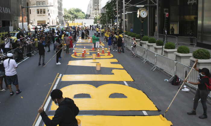 Black Lives Matter is painted on Fifth Avenue in front of Trump Tower in Manhattan, N.Y., July 9, 2020. (Mark Lennihan/AP Photo)