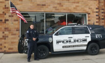 Nebraska Cop Caught on Camera Fixing Fallen American Flag Outside Auto Repair Shop