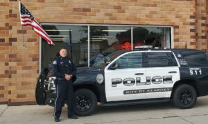 Nebraska Cop Caught on Camera Fixing Fallen American Flag Outside Auto Repair Shop