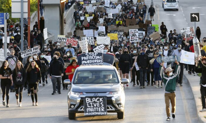 People march at a Black Lives Matter rally in Winnipeg on June 5, 2020, in solidarity with the George Floyd protests across the United States. (The Canadian Press/John Woods)