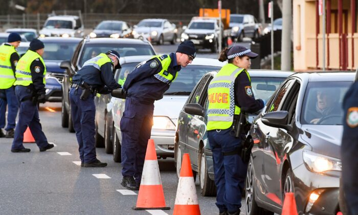 Police in the southern New South Wales (NSW) border city of Albury check cars crossing the state border from Victoria on July 8, 2020. (William West/AFP via Getty Images)