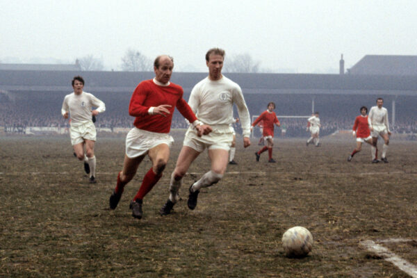 Jack Charlton and his brother Bobby Charlton in a soccer match Leeds