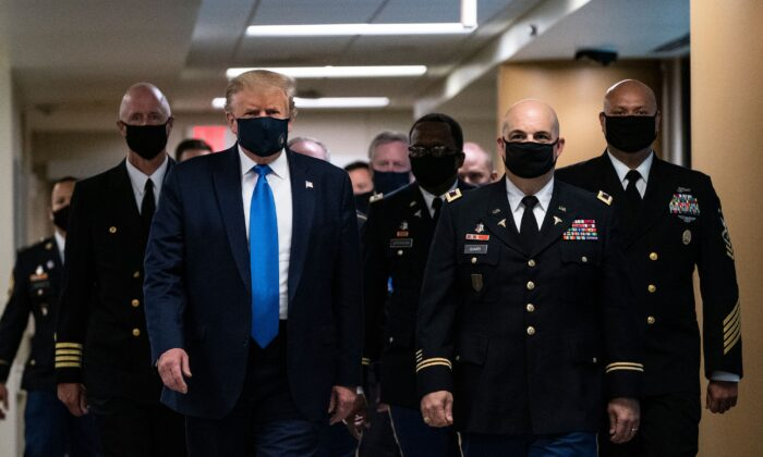 President Donald Trump wears a mask as he visits Walter Reed National Military Medical Center in Bethesda, Md., on July 11, 2020. (Alex Edelman/AFP via Getty Images)