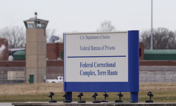 The guard tower flanks the sign at the entrance to the U.S. Penitentiary in Terre Haute, Ind., on Dec. 10, 2019. (AP Photo/Michael Conroy)