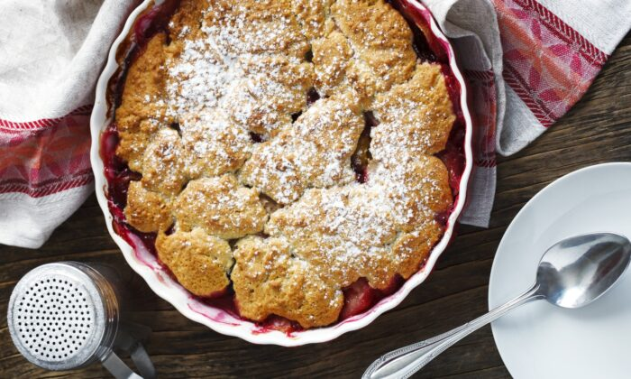 A second type of cobbler is made by topping a layer of syrupy fruit with dollops of sweet biscuit or shortbread dough. (AnjelikaGr/Shutterstock)