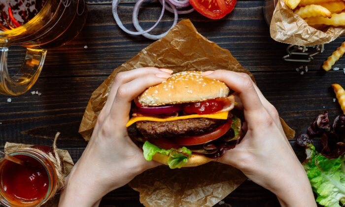 Don't let go. While a pristine burger is a thing of beauty and balance, once the first bite is taken, it wants to explode. (Fedorovacz/Shutterstock)