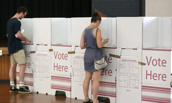 Voters are seen keeping a distance at Brisbane City Hall in Brisbane, Australia on March 28, 2020. (Jono Searle/Getty Images)