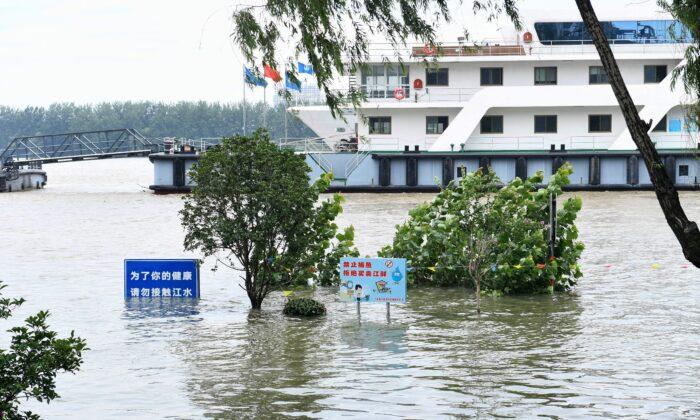 Signs are seen submerged in floodwaters on the bank of the Yangtze River in Nanjing, China on July 12, 2020. (STR/AFP via Getty Images)