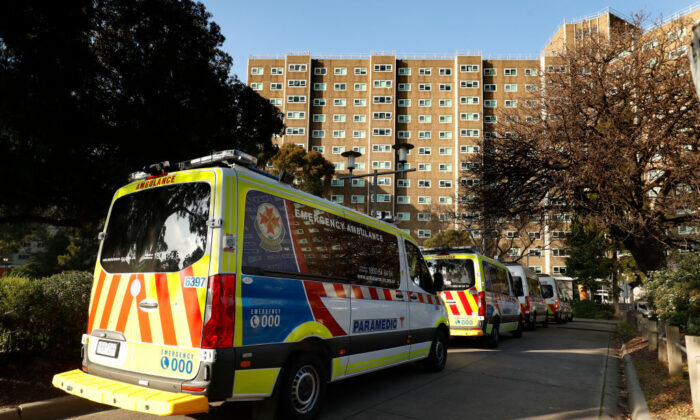A row of Ambulances are seen lined up outside the North Melbourne Public Housing tower complex in Melbourne, Australia on July 8, 2020. (Darrian Traynor/Getty Images)