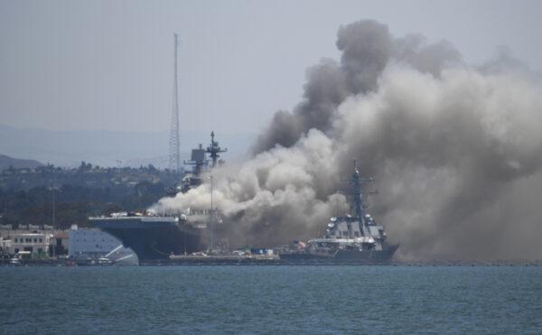 Smoke rises from the USS Bonhomme Richard