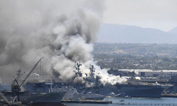 Smoke rises from the USS Bonhomme Richard at Naval Base San Diego after an explosion and fire on board the ship, on July 12, 2020. (Denis Poroy/AP Photo)