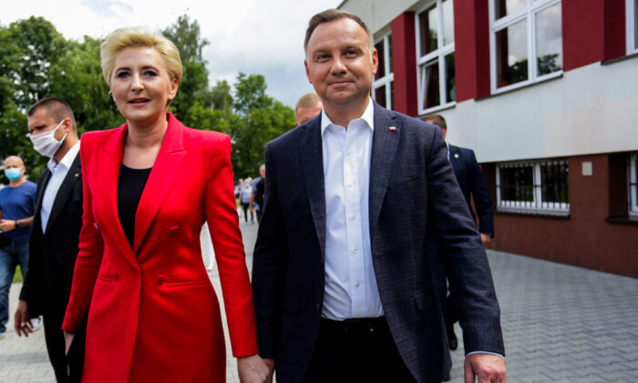 Polish President and presidential candidate Andrzej Duda and his wife Agata Kornhauser-Duda visit a polling station during the second round of a presidential election in Krakow, Poland, on July 12, 2020. (Adrianna Bochenek/Agencja Gazeta via Reuters)