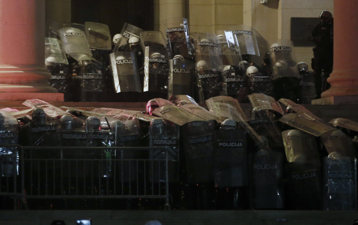 Riot police guard the Serbian parliament