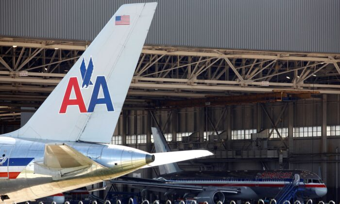 An American Airlines airliner sits near a hanger at Dallas/Fort Worth International Airport, Texas, on April 4, 2012. (Tim Sharp/Reuters)