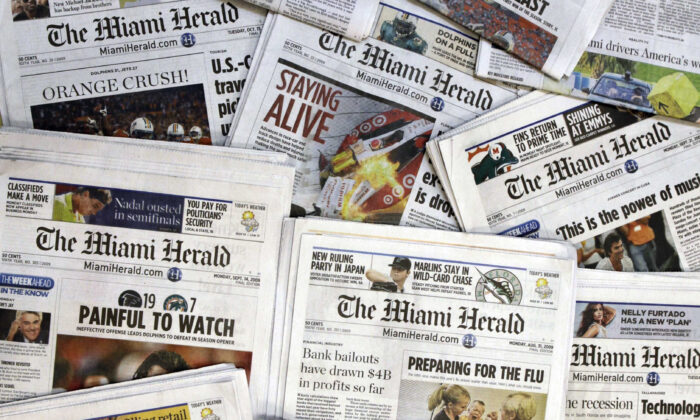 Copies of the McClatchy Co. owned Miami Herald newspaper are shown Oct. 14, 2009, in Miami. (Wilfredo Lee/AP, File Photo)