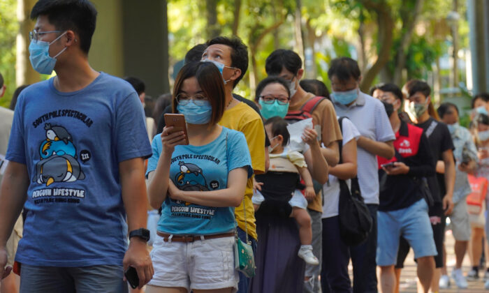 People queue up to vote in an unofficial primary for pro-democracy candidates ahead of legislative elections in September, in Hong Kong on July 12, 2020. (Vincent Yu/AP Photo)