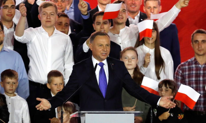 Polish President and presidential candidate of the Law and Justice (PiS) party Andrzej Duda speaks after the announcement of the first exit poll results on the second round of the presidential election in Pultusk, Poland, on July 12, 2020. (Kacper Pempel/Reuters)