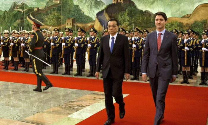 Prime Minister Justin Trudeau walks with Chinese Premier Li Keqiang during a welcome ceremony held at the Great Hall of the People in Beijing on Dec. 4, 2017. (AP Photo/Ng Han Guan)