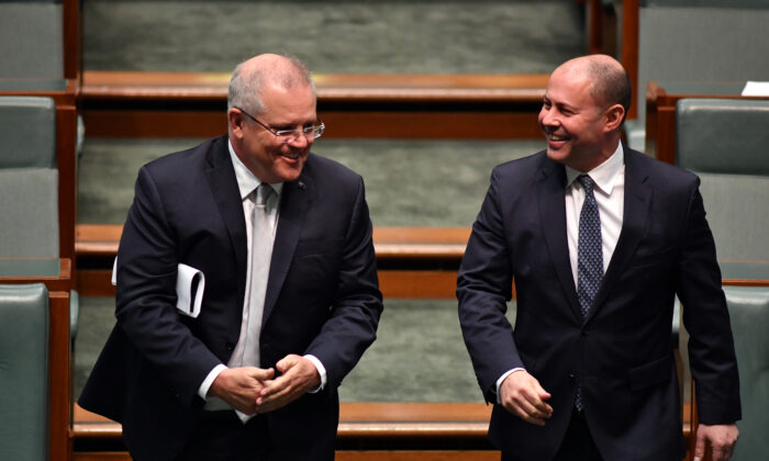 Prime Minister Scott Morrison and Treasurer Josh Frydenberg arrive in the House of Representatives at Parliament House in Canberra, Australia on May 13, 2020. (Sam Mooy/Getty Images)
