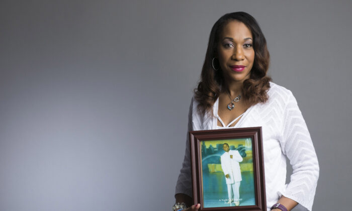 Pamela Bosley holds a picture of her son, Terrell Bosley, who was killed by gunfire in a church parking lot in Chicago, Ill., at the age of 18. Bosley founded a support group for mothers who have lost their children to gun violence, called Purpose Over Pain. (Todd Rosenberg)