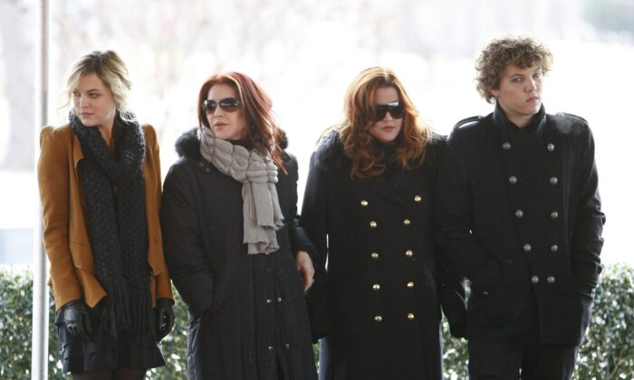 Priscilla Presley, second from left, her daughter, Lisa Marie Presley, second from right, and Lisa Marie's children, Riley Keough, left, and Benjamin Keough, right, take part in a ceremony in Memphis, Tenn., on Jan. 8, 2010. (Mark Humphrey/AP Photo)