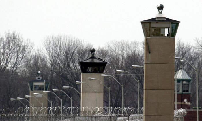 Guard towers and razor wire ring the compound at the U.S. Penitentiary in Terre Haute, Ind., on March 17, 2003. (Michael Conroy/AP Photo)