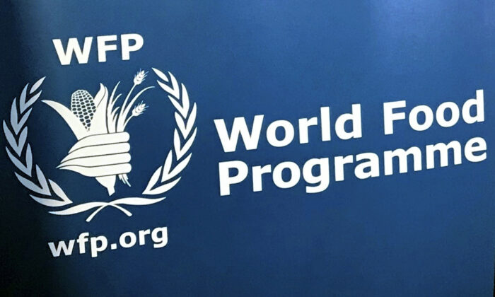 The U.N. World Food Program's logo is seen at the agency's headquarters in New York. Nov. 6, 2017. The United Nations says the ranks of the world's hungry grew by 10 million last year and warns that the coronavirus pandemic could push as many as 130 million more people into chronic hunger this year. The grim assessment is contained in an annual report released Monday, July 13 2020 by the five U.N. agencies that produced it. (Robert Bumstead/AP Photo)