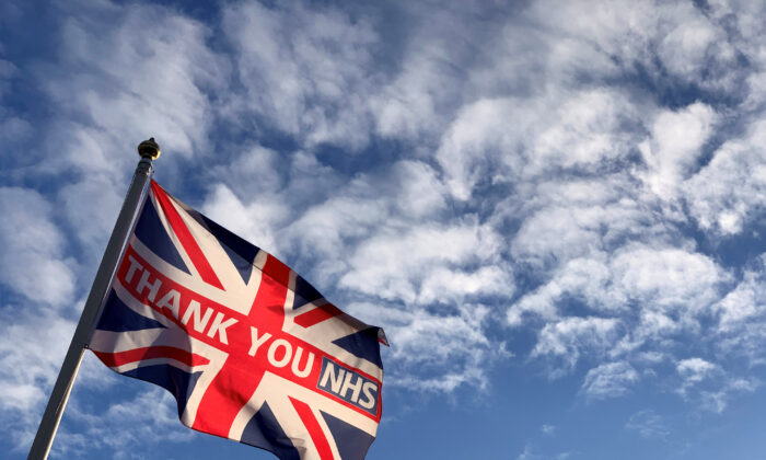 A British national flag, known as the Union Jack, with the words 'THANK YOU NHS' (National Health Service) is caught in an early morning breeze in London, Britain, on July 6 2020. (Russell Boyce/Reuters)