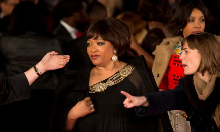 """Zindzi Mandela, the daughter of the late Nelson Mandela poses for photographers as she arrives to attend the UK premiere of the movie """"Mandela: Long Walk to Freedom"""" at a cinema in London, UK., on Dec. 5, 2013. (Matt Dunham/File/AP Photo)"""
