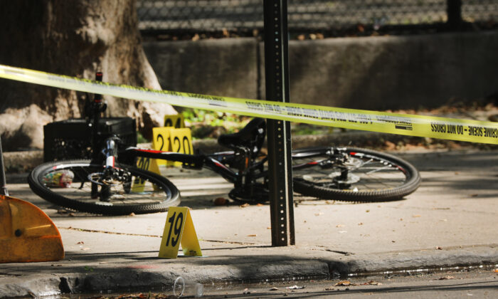 Police ballistic markers stand beside a child's bicycle at a crime scene where a 1-year-old child was shot and killed in New York City, on July 13, 2020. (Spencer Platt/Getty Images)