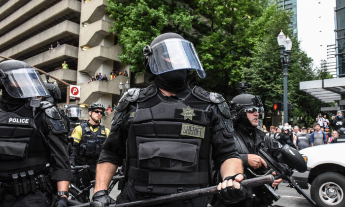 Portland police respond to protesters during a previous rally in Portland, Oregon, on Aug. 17, 2019. (Stephanie Keith/Getty Images)