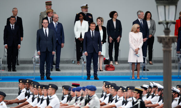 French President Emmanuel Macron, his wife Brigitte Macron and French Prime Minister Jean Castex attend the Bastille Day celebrations on Place de la Concorde in Paris, France, on July 14, 2020. (Benoit Tessier/Reuters)