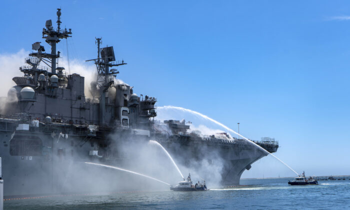 Port of San Diego Harbor Police Department boats combat a fire on board USS Bonhomme Richard (LHD 6) at Naval Base San Diego, July 12, 2020. (Navy photo by Mass Communication Specialist 3rd Class Christina Ross)