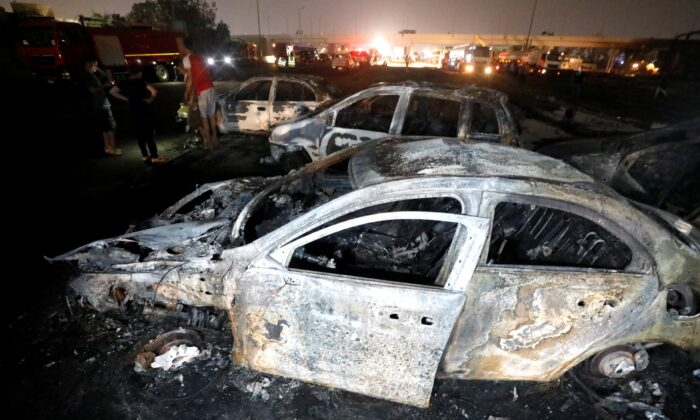 Burned vehicles are seen following a fire that broke out in Egypt's Shuqair-Mostorod crude oil pipeline, at the beginning of Cairo-Ismailia road, Egypt, on July 14, 2020. (Mohamed Abd El Ghany/Reuters)