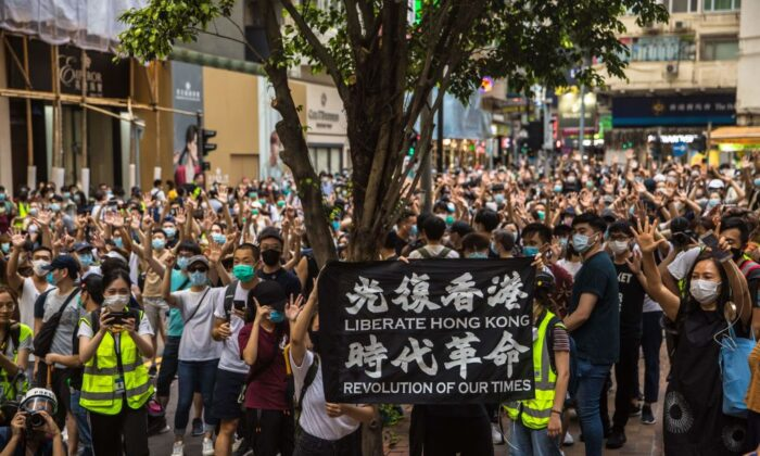 Protesters chant slogans during a rally against the Beijing-imposed new national security law in Hong Kong on July 1, 2020. (Dale De La Rey/AFP via Getty Images)