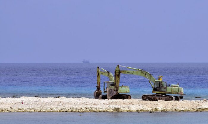 Two excavators are pictured at a construction site on Taiping island in the Spratly chain in the South China Sea on March 23, 2016. (Sam Yeh/AFP via Getty Images)