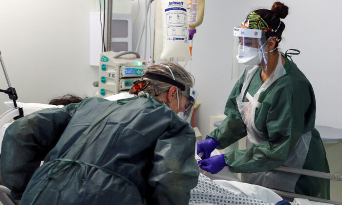 Nurses care for a patient in an Intensive Care ward treating victims of the coronavirus disease (COVID-19) in Frimley Park Hospital in Surrey, Britain, May 22, 2020. (Steve Parsons/Reuters)