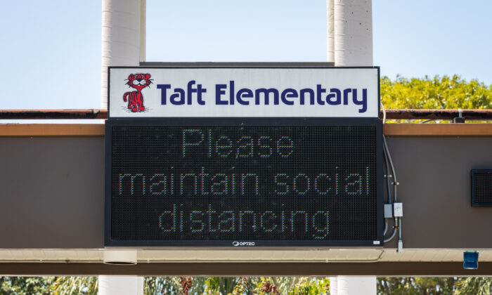 A sign at Taft Elementary School in Santa Ana, Calif., urges people to maintain social distancing on July 13, 2020. (John Fredricks/The Epoch Times)
