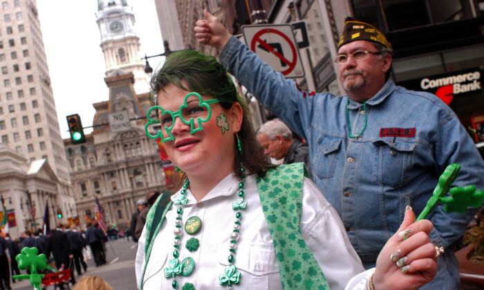 A woman watches the St. Patrick's Day Parade in Philadelphia, Penn., on March 14, 2004. City officials announced a six-month moratorium on public events on July 14, 2020. (William Thomas Cain/Getty Images)